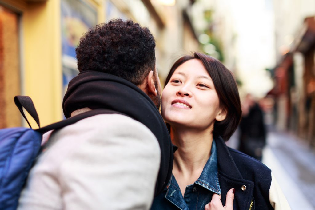 Young adults greeting on the streets of Paris