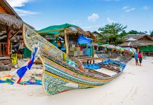 A long tail boat on Krabi Beach on Phi Phi Island, places to visit in Thailand.