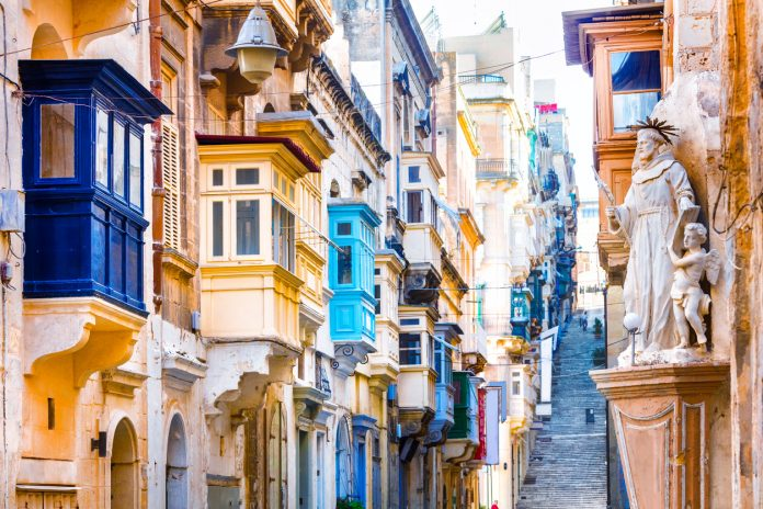 Typical Narrow Streets With Colorful Balconies In Valletta, Malta,Europe.