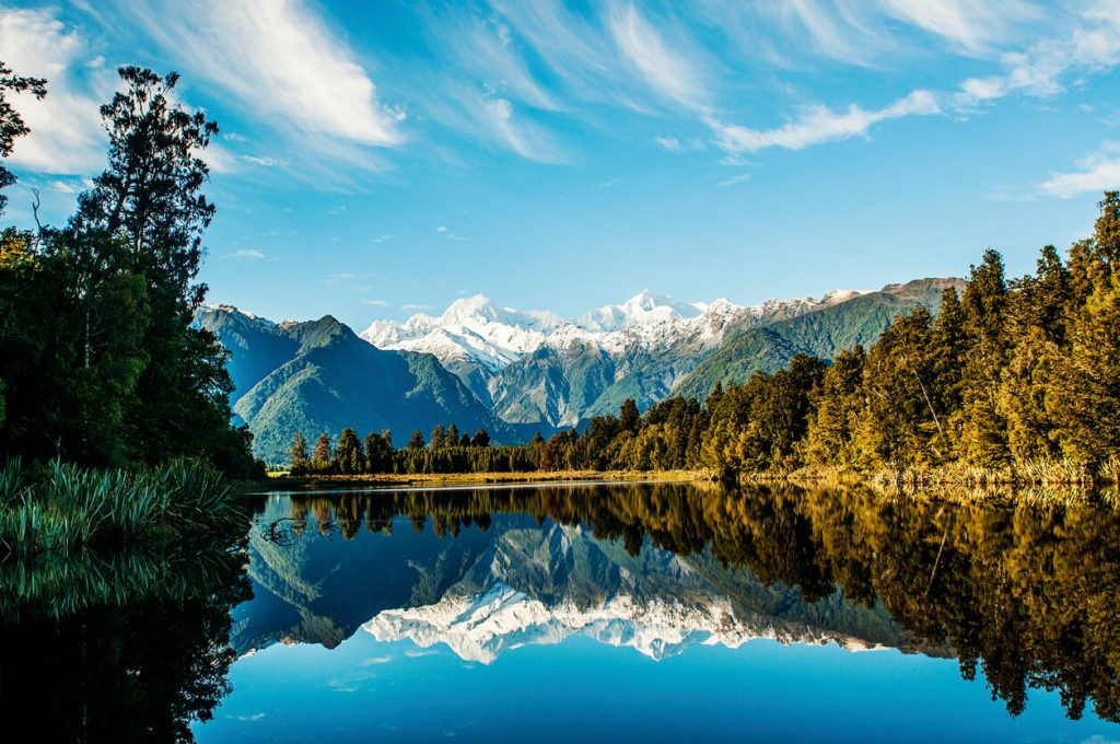 Reflections of Mount Cook and Mount Tasman in Lake Matheson, Fox Glacier New Zealand.