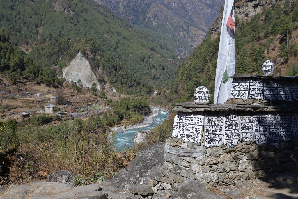 A stream in the valley with a local monument - everest base camp