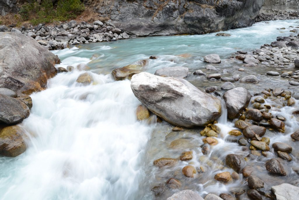 A stream gushing over rocks - everest base camp