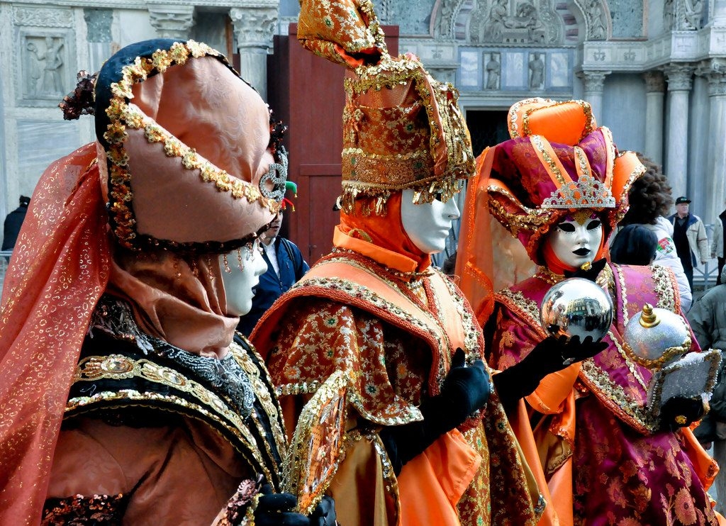 Masked revelers enjoy the Venetian Carnival