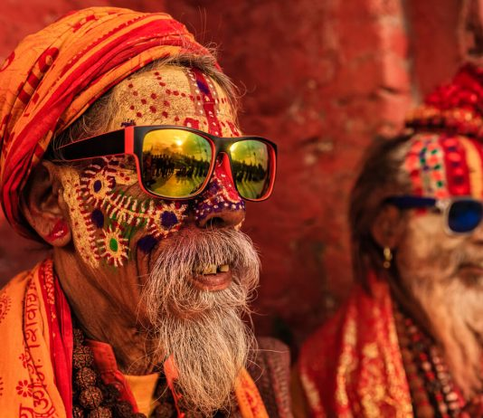 Indian holy men sitting at the temple in Varanasi