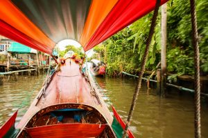 A boat on the canals of the Chao Phraya River - unusual things to do in Bangkok