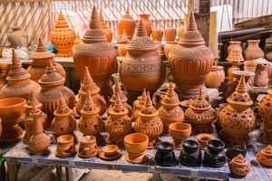 Various pottery items on display - unusual things to do in Bangkok