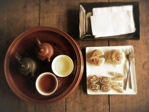 Tea and refreshments on a table - unusual things to do in Bangkok