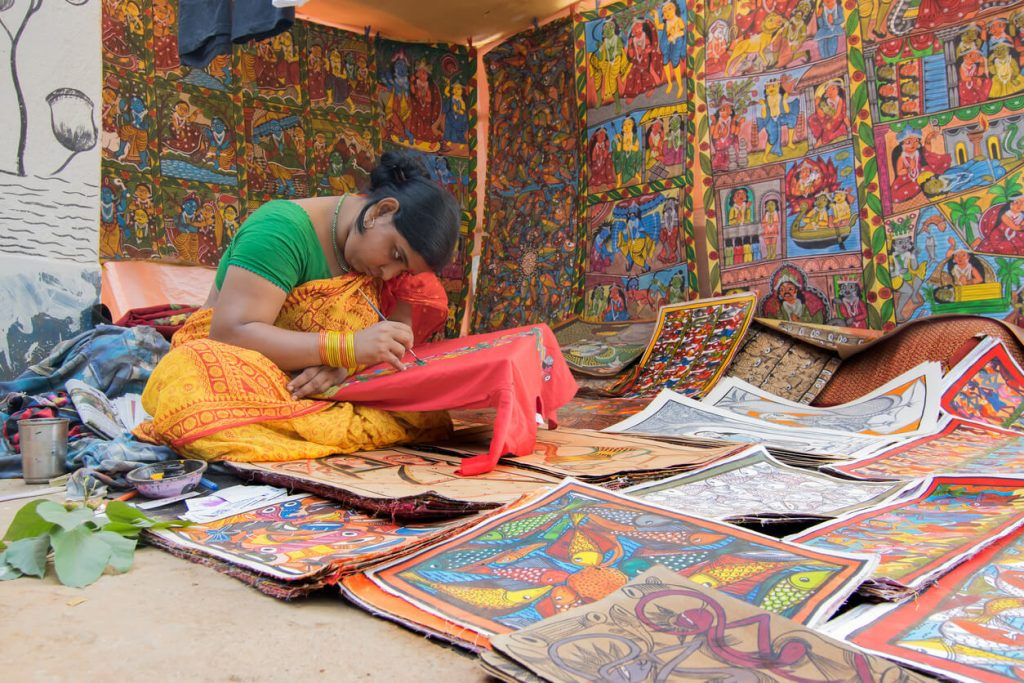 Colorful handicrafts being prepared for sale at Pingla village, West Bengal, India