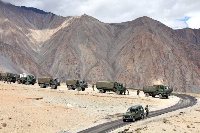 Indian army convoy of trucks in Kashmir