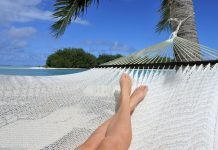 woman relaxing on a hammock by the beach