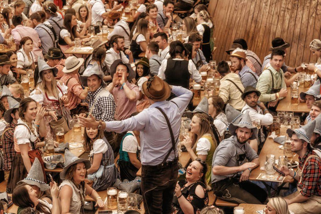 People celebrating in beer pavilion on Oktoberfest-fest in Munich