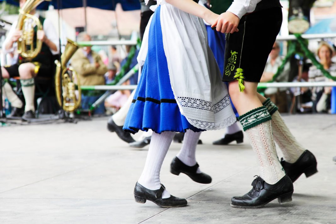 Festivals in germany, Bavarian couple dancing at Oktoberfest