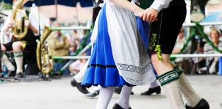 Festivals in germany, Bavarian couple dancing at Oktoberfest