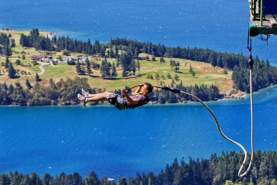 Man taking the plunge from a Ledge bungy jumping, Queenstown,New Zealand, Harry Potter
