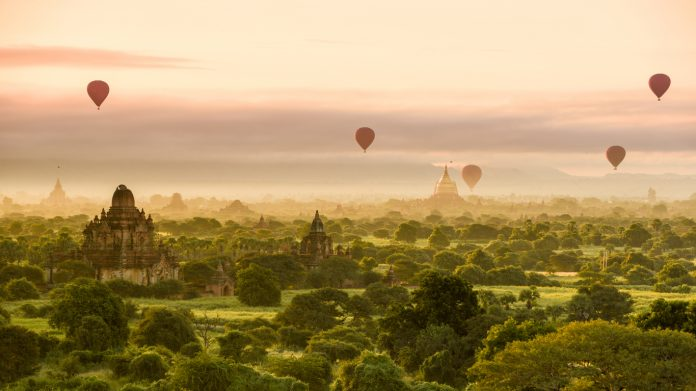 Hot air balloons dot the morning sky in Bagan, Myanmar, things to see in Myanmar