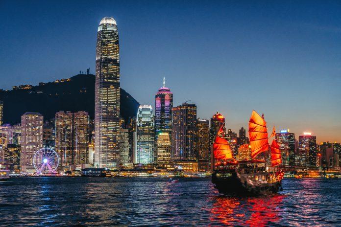 Traditional junk boat sailing across Victoria Harbour, Hong Kong.