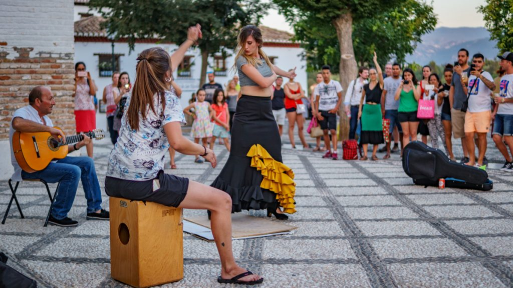 Flamenco dancer dances for tourists in St. Nicolas viewpoint, Spain, Visit to spain