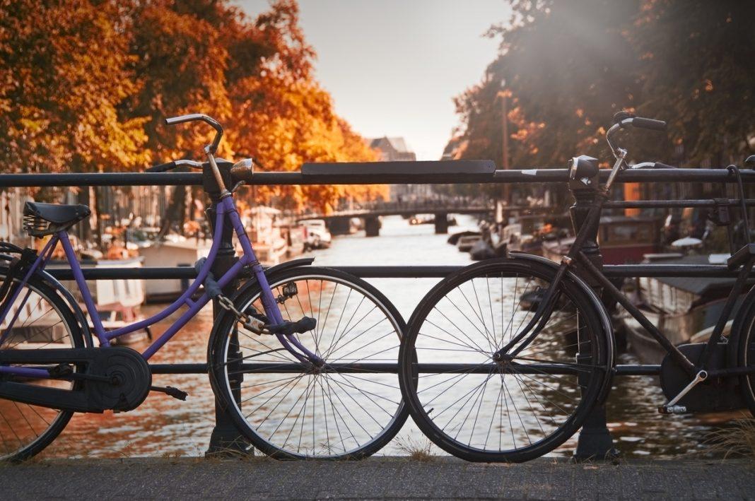 Two bikes on a bridge in Amsterdam