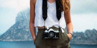 Woman mountain lake shorts camera