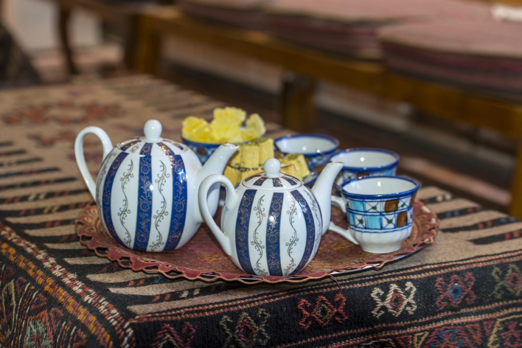 Typical teapots and cups in a traditional tea house in Iran