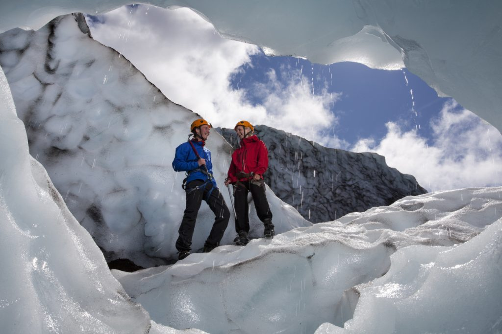 Couple hiking through the glaciers, Iceland, best adventure trips for couples