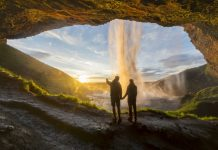 Couple under the waterfall, Iceland, best adventure trips for couples