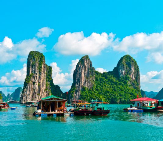 Vietnam budget travel, Floating village and rock islands in Halong Bay, Vietnam, Southeast Asia,