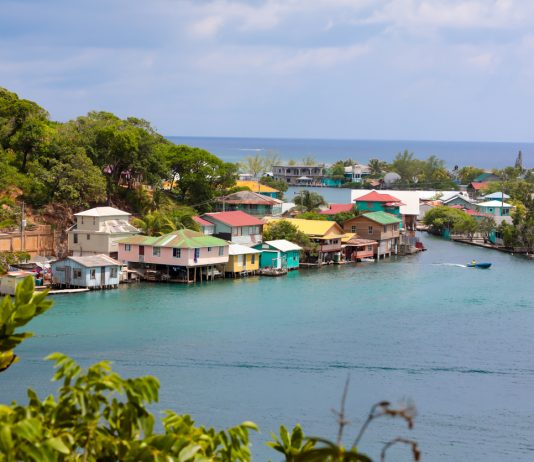 Seaside village on Roatain, which is part of the Bay Islands of Hondouras. It is the largest of the Bay Islands and an eco-tourism destination. Colorful wooden stilt homes dot the landscape. Honduras tourism