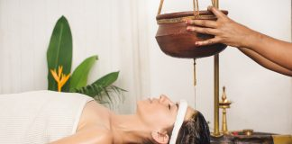 Kerala Ayurvedic massages, Tourist having Ayurveda shirodhara treatment in India