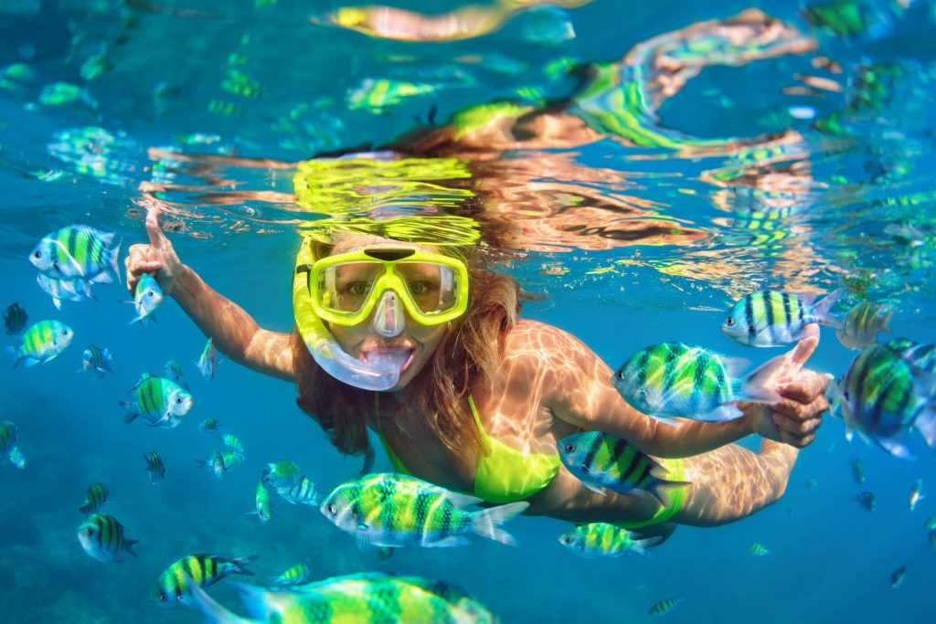 A girl snorkelling in Phuket - top 7 islands in Thailand