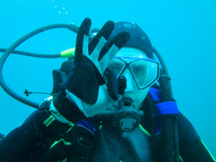 Man scuba diving in Galapagos, Ecuador.