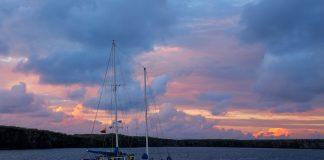 Sailboat at sunrise in Great Darwin Bay, Genovesa Island, Ecuador