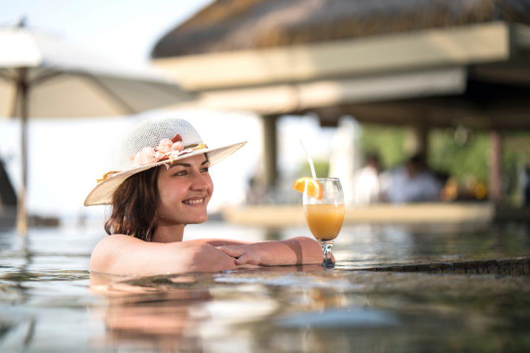 Tourist enjoying in a swimming pool, Seychelles