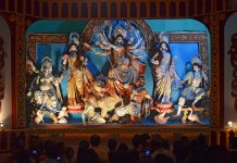 People celebrating Durga Puja Pandal (decorated temporary temple). Biggest religious festival of Hinduism and local Bengali community, Tripura, India, Durga Pooja Delicacies, Dussera Destinations