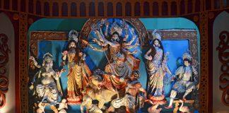 People celebrating Durga Puja Pandal (decorated temporary temple). Biggest religious festival of Hinduism and local Bengali community, Tripura, India, Durga Pooja Delicacies, Dussera Destinations