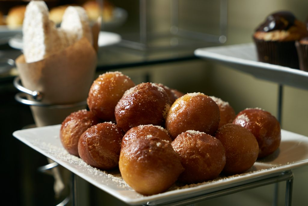 Homemade loukoumades donuts with honey and cinnamon