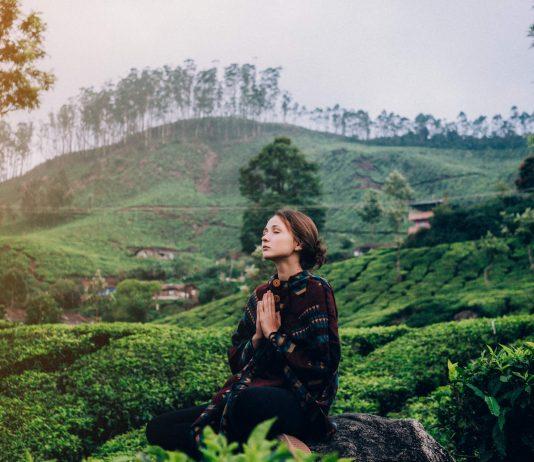 woman meditating in the tea plantations of Kerala