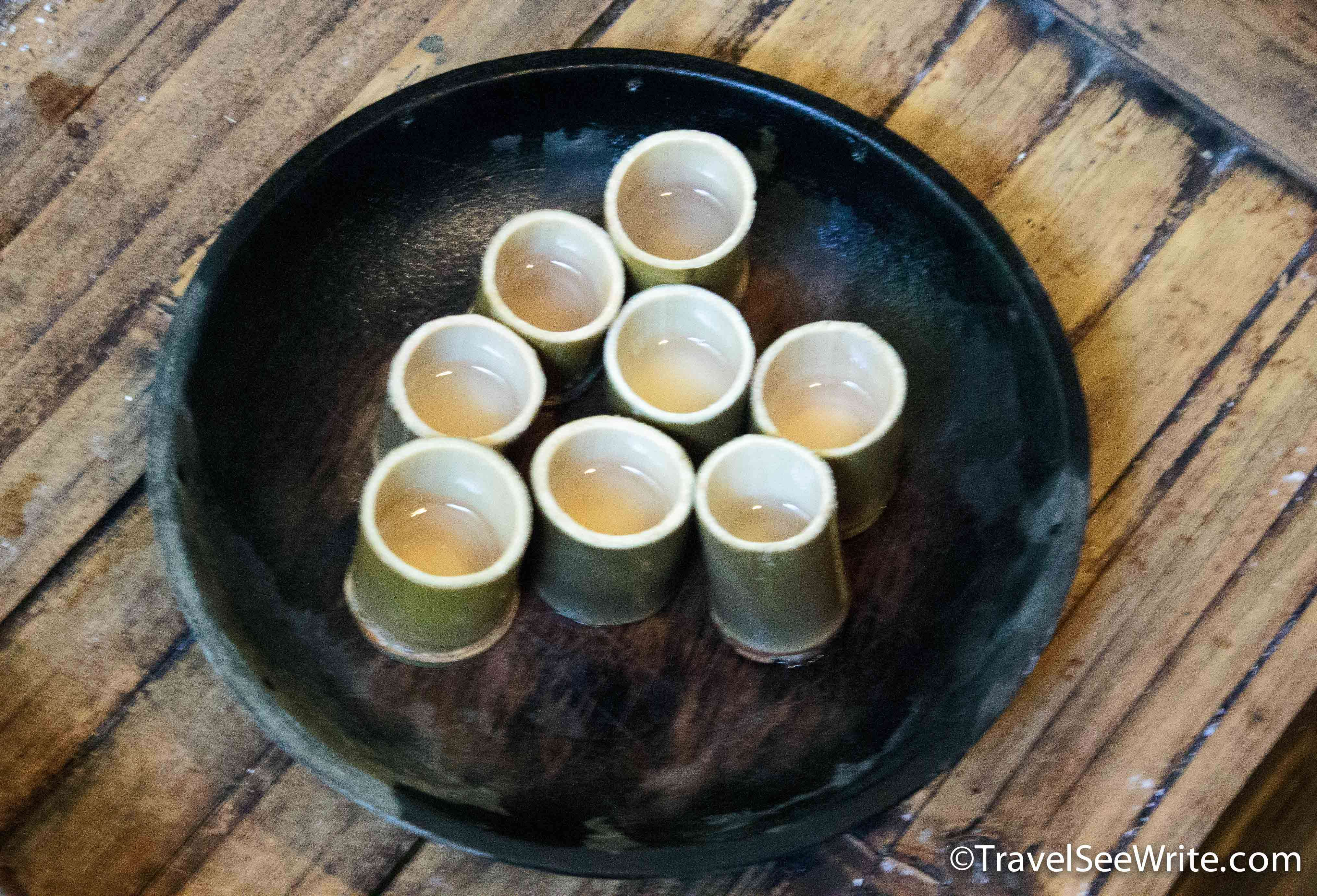 Homemade rice wine in bamboo glasses at Mari Mari Cultural village - southeast asia travel