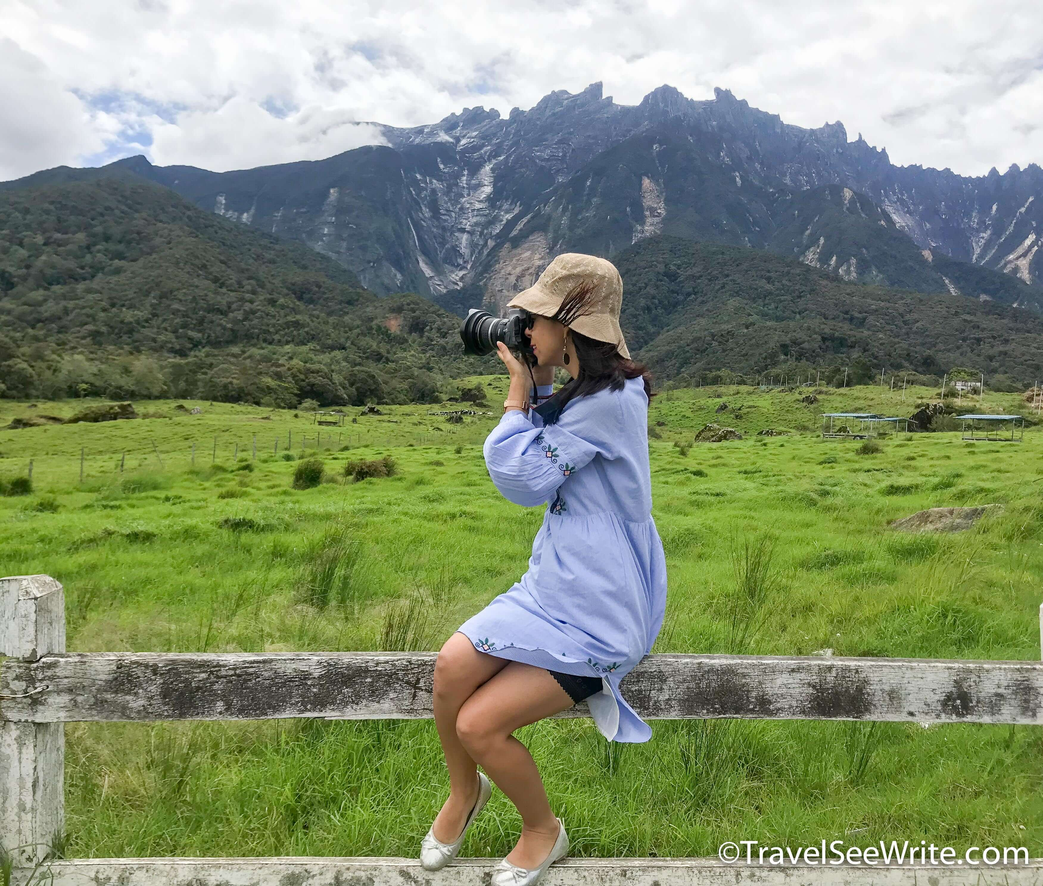 Lady clicking a photot of Mount Kinabalu in the background - southeast asia travel