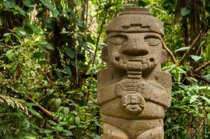 An ancient, flute playing, pre-columbian statue in San Agustin, Colombia