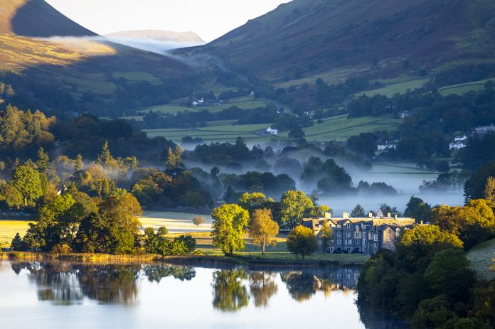 Misty October sunrise in Grasmere, in the English Lake District.