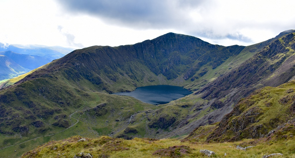 A welsh mountain with a lake half way up called cadair Idris