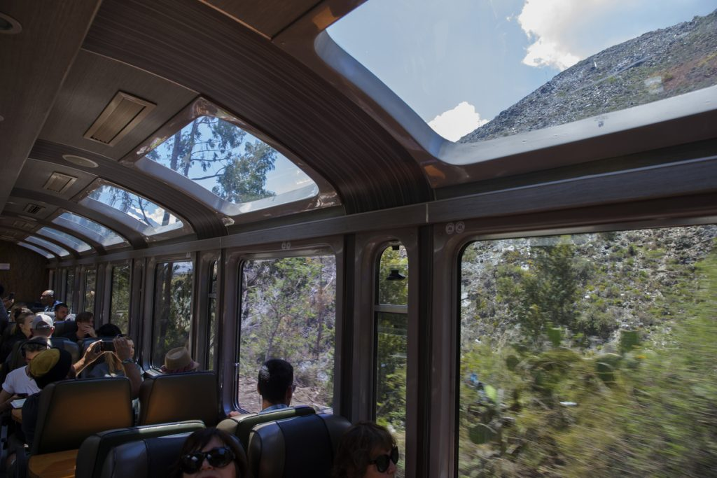 Inside of a Peru Rail train going to historical site of Machu Picchu. Wide windows on the side and roof of the train provide a great scenery, Cusco, Peru