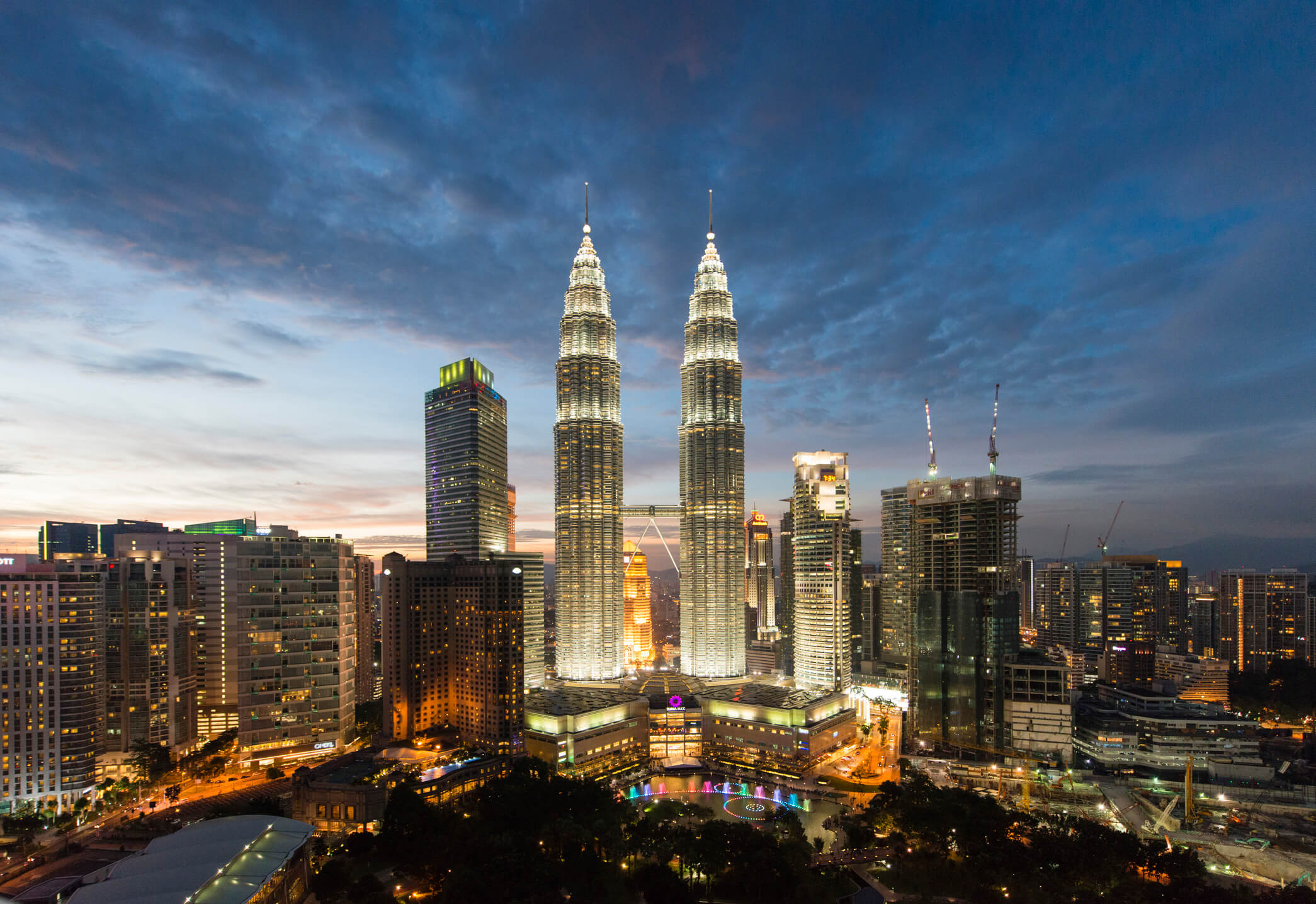 Petronas twin towers lit up at dusk - things to do in Kuala Lumpur