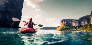 lady Kayaking in the waters off Railay beach, Krabi - places to see in Krabi