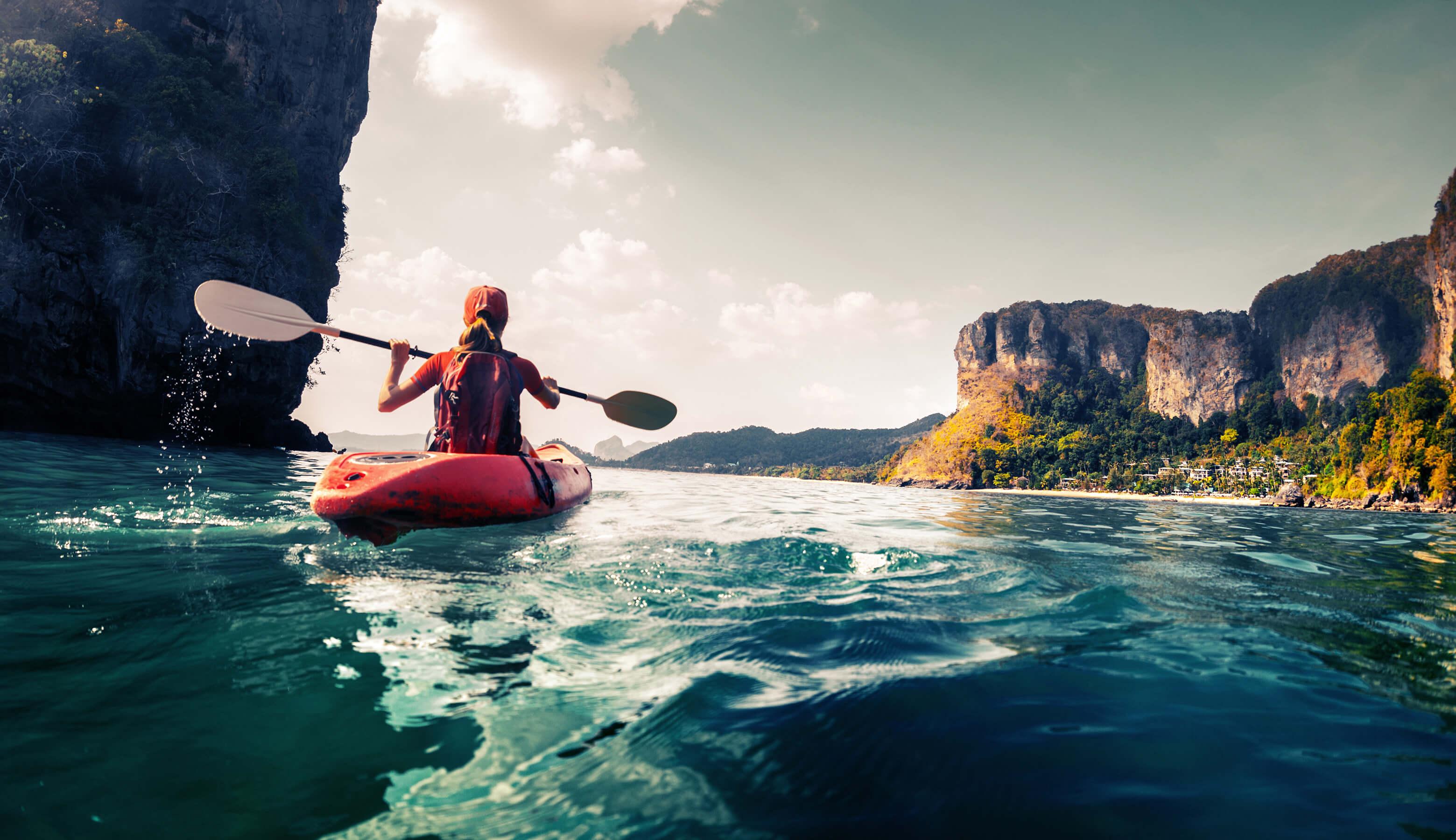 lady Kayaking in the waters off Railay beach, Krabi - places to see in Krabi
