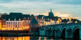 View at the famous Dutch Sint Servaas bridge with christmas lights in the city center of Maastricht
