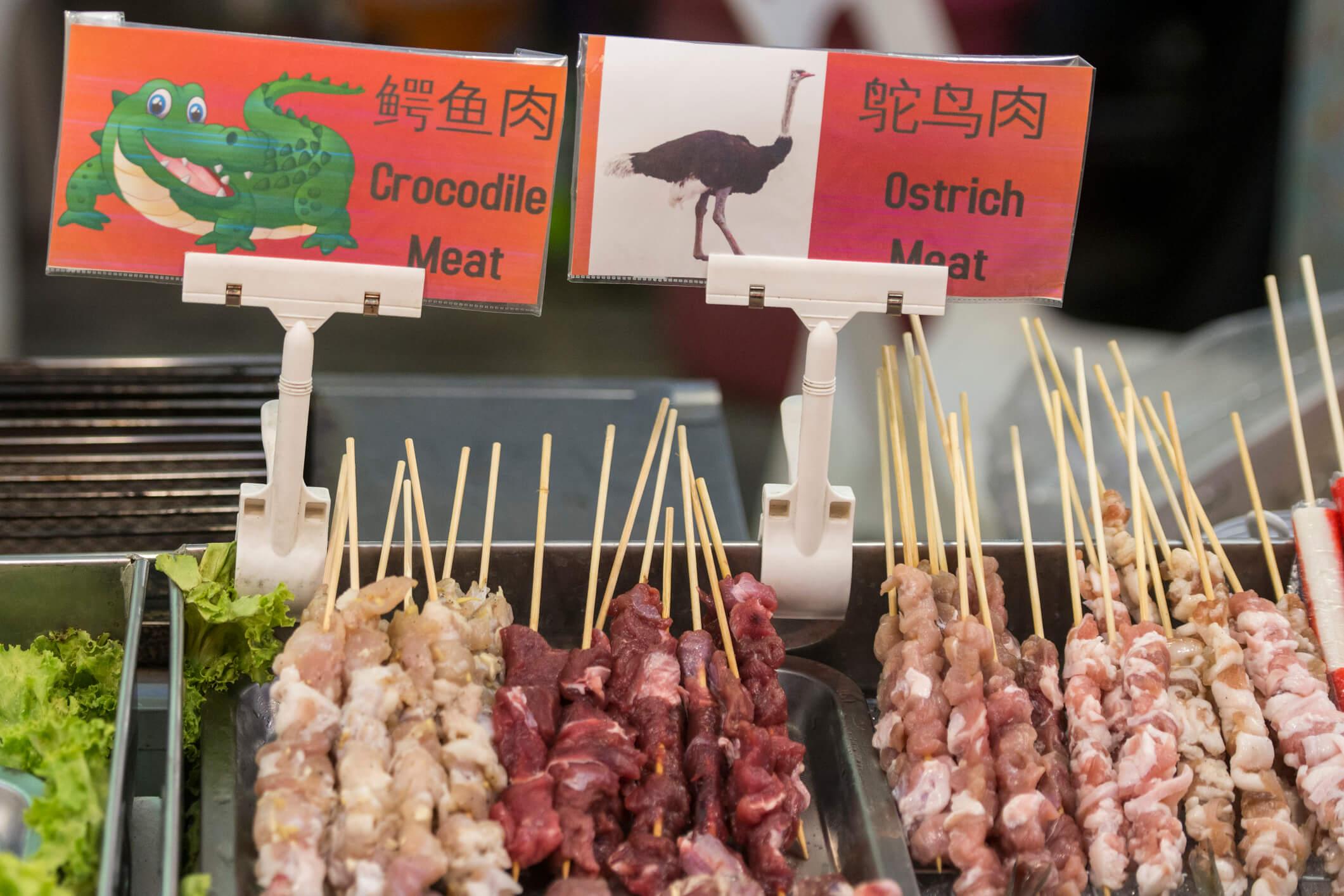 crocodile and ostrich meat skewers - best street food in Bangkok
