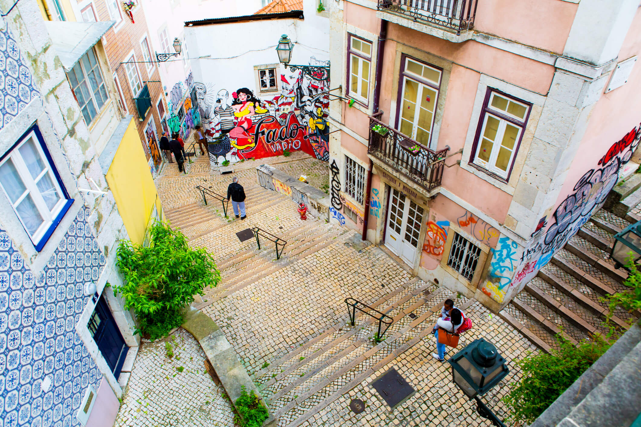 Stairs, buildings and street art in Alfama - what to see in lisbon