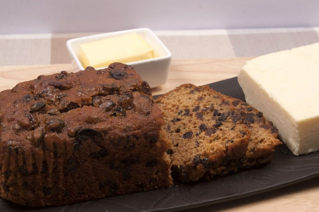 A traditional Welsh fruit loaf called Bara Brith with Welsh cheese and butter